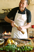 Chef preparing fish for the grill at Le Domaine de Foncaudiere, France