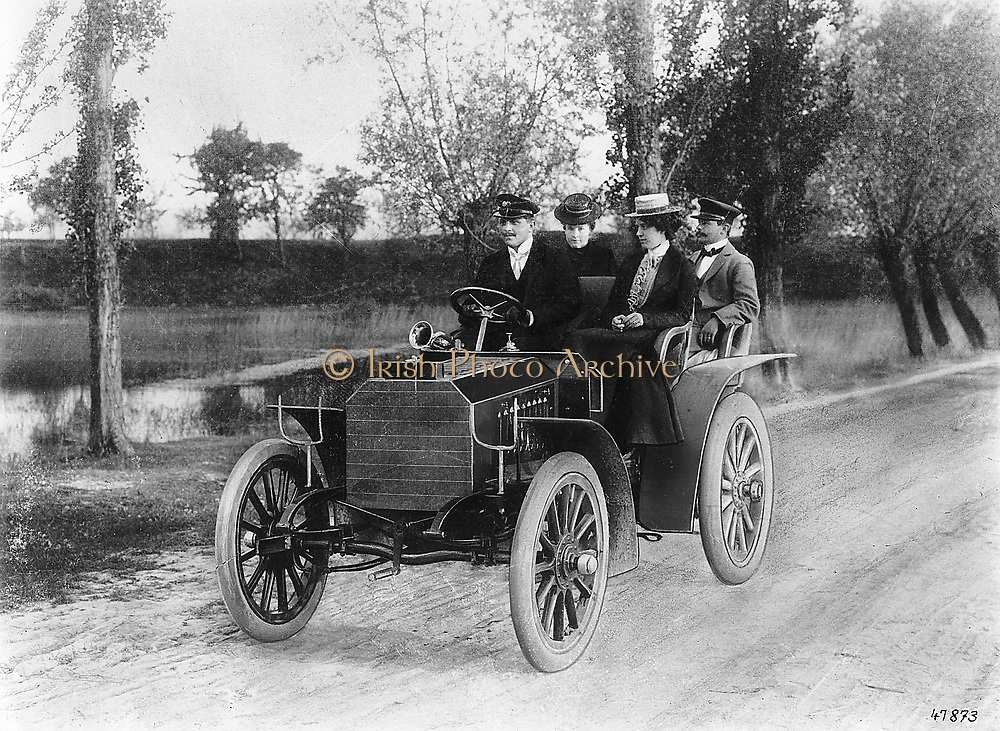 Mercedes 35 PS motor of 1901. In the back are Adolph Daimler (1834-1900) German engineer and inventor,  and his wife Mercedes.