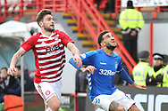 Hamilton Accademical forward George Oakley (9) and Rangers defender Connor Goldson (6) look for the ball during the Ladbrokes Scottish Premiership match between Hamilton Academical FC and Rangers at New Douglas Park, Hamilton, Scotland on 24 February 2019.