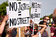 """15 AUGUST 2020 - MINNEAPOLIS, MINNESOTA: People rally at the George Floyd Memorial in front of Cup Foods in Minneapolis. Floyd, an unarmed Black man, was killed by Minneapolis police officers of May 25 in front of Cup Foods, a convenience store at the intersection of 38th and Chicago Ave. His killing sparked a week of violent protests across the country. The intersection where he was killed is still closed and has become an unofficial memorial visited by hundreds of people every day. Saturday, more than 100 people gathered at the memorial to demand the city preserve the memorial. On Saturdays in August, the intersection has a market, with venders selling Afro-centric merchandise. The city of Minneapolis had planned to start reopening the intersection as soon as Monday Aug. 17, but delayed those plans indefinitely on Friday, Aug. 14. City residents have created a """"George Floyd Zone"""" at the intersection. They're demanding the recall of Hennepin County Attorney Mike Freeman, requiring Minneapolis police officers have their own private liability insurance, and the allocation of funds for businesses and residents in the community. The city is considering officially renaming Chicago Ave. between 37th and 39th """"George Floyd Jr. Place.""""     PHOTO BY JACK KURTZ"""
