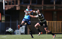 Ulrich Beyers of the Blue Bulls kicks as Adriaan Carelse of Boland makes the challenge during the Currie Cup premier division match between the Boland Cavaliers and The Blue Bulls held at Boland Stadium, Wellington, South Africa on the 23rd September 2016<br /> <br /> Photo by:   Shaun Roy/ Real Time Images