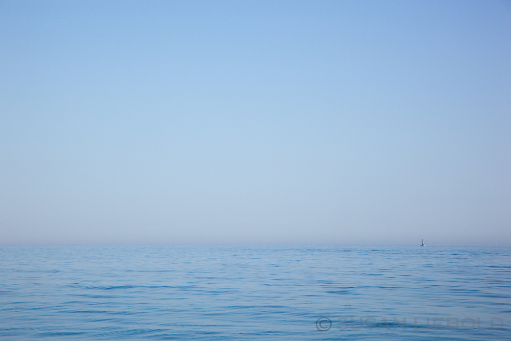 A boat on the horizon in the Ionian sea off the coast of southern Italy.