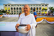 """01 JANUARY 2013 - BANGKOK, THAILAND:   A Buddhist nun at a special merit making ceremony at Bangkok City Hall New Year's morning. Many Thais go to Buddhist temples and shrines to """"make merit"""" for the New Year. The traditional Thai New Year is based on the lunar calender and is celebrated in April, but the Gregorian New Year is celebrated throughout the Kingdom.    PHOTO BY JACK KURTZ"""