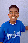 African American teen age 16 smiling at Youth Express office.  St Paul Minnesota USA