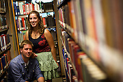 """Michael Goldfien and Erica Seltzer-Schultz (both '12) pose for a portrait in an aisle of Burling Library on Thursday. Goldfien and Seltzer-Schultz examined the American Zionist movement in their Baumann Prize-winning essay entitled """"Zionism, Liberalism, and Young American Jews: How Redefining the American Zionist  Could Help Bring Peace to the Middle East."""""""