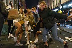 © Licensed to London News Pictures.  24/04/2021. London, UK. Members of the public make the most of Saturday night out in Soho, central London as lockdown restriction were eased last week. Photo credit: Marcin Nowak/LNP