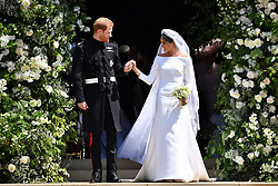 File photo dated 19/05/2018 of Prince Harry and Meghan Markle leaving at St. George's Chapel in Windsor Castle after their wedding ceremony as Princess Eugenie and fiance Jack Brooksbank are following in the footsteps of the Duke and Duchess of Sussex, Earl of Wessex and the QueenÕs eldest grandson Peter Phillips by marrying in St GeorgeÕs Chapel.