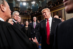 FEBRUARY 5, 2019 - WASHINGTON, DC: President Trump shook hands with Supreme Court Justice John Roberts after the State of the Union at the Capitol in Washington, DC, USA on February 5, 2019. Photo by Doug Mills/Pool via CNP/ABACAPRESS.COM
