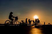 Women offer mobile manicure and pedicure services on the Mekong waterfront. They carry nail files, clippers, creams and lotions in their bicycle baskets, Night Market, Vientiane, Laos