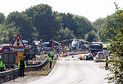 © Licensed to London News Pictures. 22/08/2015. Shoreham Airshow, UK. Wreckage and emergency services at the scene where a Fighter jet smashed into cars on the A27 road in front of thousands of spectators at Shoreham Airshow in West Sussex, UK. Photo credit:Sean Hawkey/LNP