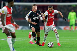 Hakim Ziyech #22 of Ajax and Jordy Clasie #20 of AZ Alkmaar in action during the Dutch Eredivisie match round 25 between Ajax Amsterdam and AZ Alkmaar at the Johan Cruijff Arena on March 01, 2020 in Amsterdam, Netherlands