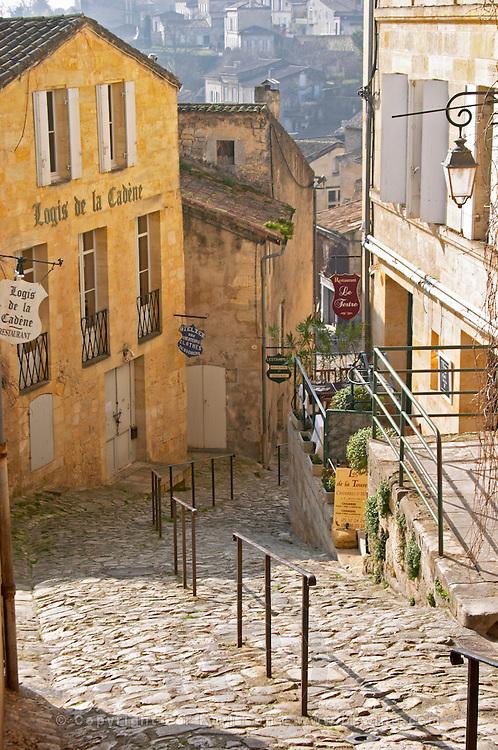 Macarons, almond bisquits. Patisserie shop in a steep cobble stone street. The town. Saint Emilion, Bordeaux, France