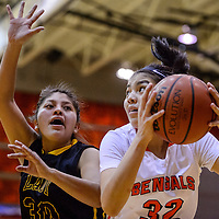 Gallup Bengal Rhiannon Singer (32) presses in against Tohatchi Cougar Cheyenne Begay (30) Thursday at Gallup High School.