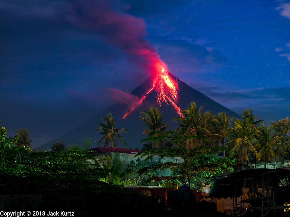 23 JANUARY 2018 - LEGAZPI, ALBAY, PHILIPPINES: As seen from Legazpi, about 13 kilometers from the volcano, Mayon volcano erupts Tuesday night. Mayon is the most active volcano in the Philippines. After a series of eruptions Monday, the alert level for the area was raised to four for the first time since 2009.   PHOTO BY JACK KURTZ
