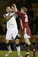 Photo: Aidan Ellis.<br /> Bradford City v Swansea City. Coca Cola League 1. 13/01/2007.<br /> Swansea's tom Williams gets into some pushing with Bradford's Joe Colbeck
