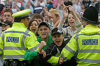 Photo: Glyn Thomas.<br />Chesterfield v Swansea City. Coca Cola League 1. 06/05/2006.<br />Swansea fans are held back by the police.