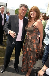 Actor BILLY MURRAY and his wife ELAINE MURRAY at the Kuoni World Class Polo Day at Hurtwood Park Polo Club, Surrey on 28th May 2006.<br />