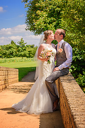 Bride and Groom on bridge at the Bicester Hotel Golf & Spa