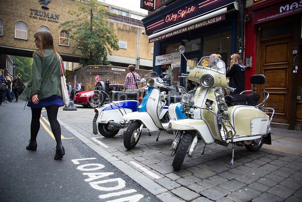 Vintage Lambretta mopeds on Brick Lane, East London, UK. Lambretta was a line of motor scooters originally manufactured in Milan, Italy by Innocenti. They are now very much sought after by collectors and in particular people interested in the Mod era.