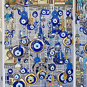 Orthodox greek souvenirs - small icons and blue round eyes in Crete, Greece