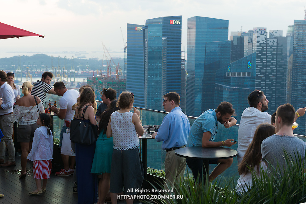People in the bar of Marina Bay Sands hotel, Singapore