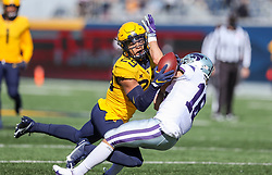 Oct 31, 2020; Morgantown, West Virginia, USA; West Virginia Mountaineers safety Sean Mahone (29) intercepts a pass intended for Kansas State Wildcats wide receiver Eric Hommel (18) during the first quarter at Mountaineer Field at Milan Puskar Stadium. Mandatory Credit: Ben Queen-USA TODAY Sports