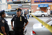 MANHATTAN, NEW YORK, AUGUST 13, 2009<br />Scene of a robbery and murder at 125th Street between Broadway and Amsterdam Avenues in Manhattan, NY.  The store owner of Blue Fame shot four people who tried to rob him this afternoon. 8/14/2009 Photo by Jennifer S. Altman/For The Times