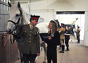 © Licensed to London News Pictures. 02/05/2013. London, UK Trumpeter Grey Marengo held by Trooper Watson is inspected by groom Grace Shayler. The Household Cavalry receive a horse health check at Hyde Park Barracks from pet charity Blue Cross in order to encourage horse owners to take part in the National Equine Health Survey (NEHS). Photo credit : Stephen Simpson/LNP