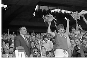 All Ireland Hurling Finals.1986..07.09.1986..09.07.1986..7th September 1986..September,every year,is the highlight of the GAA calendar with The All Ireland Finals being held in both codes. The senior and minor finals in each code are both played for on the same day. Each finalist has battled through provinical and knock out stages to reach the final.It is widely regarded as the pinnacle of a players career to reach and win an All Ireland Championship..In this years hurling finals,Cork played Offaly in the minor championship and a much fancied Galway team took on Cork in the senior final. Both matches were well fought and close encounters...Photograph of the winning captain,Tom Cashman, as he holds the Liam McCarthy Cup aloft, much to the delight of the surrounding Cork fans.