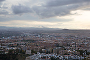 View across the city or Granada, Andalucia, Spain. Granada is a city and the capital of the province of Granada, in the autonomous community of Andalucia, Spain. Granada is located at the foot of the Sierra Nevada mountains.