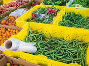 "09 JUNE 2012 - PHOENIX, AZ: Green beans, heirloom tomatoes and radishes for sale at the Roadrunner Farmers' Market. The Roadrunner Farmer's Market, in Roadrunner Park in Phoenix, is one of the most popular farmers' markets in the Phoenix area. Unlike many of the other farmers' markets, it's open year round. Most of the vendors in the market are local small scale farmers who practice sustainable agriculture. The market is very popular with ""locavores,"" people interested in eating food that is locally produced and not moved long distances to market.    PHOTO BY JACK KURTZ"