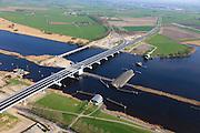 Nederland, Flevoland-Overijssel, Ramspol, 01-05-2013; nieuwe Ramspolbrug in de N50 gezien in de richting van Overijssel met voor de brug de balgstuw.  De vaargeul in het Ramsdiep met strekdam. Ramspol, inflatable dike, between Ketelmeer and Black Water. The Balgstuw (bellow barrier) is a storm barrier and consists of an inflatable dam or dyke, composed of three bellows. Usually, each bellow rests on the bottom of the water, but now the bellows are inflated  because of maintenance. luchtfoto (toeslag op standard tarieven)<br /> aerial photo (additional fee required)<br /> copyright foto/photo Siebe Swart<br /> luchtfoto (toeslag op standard tarieven)<br /> aerial photo (additional fee required)<br /> copyright foto/photo Siebe Swart