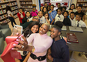 Houston ISD Trustee Jolanda Jones takes a selfie with students during a library dedication at Attucks Middle School, January 18, 2017.