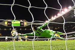 Tottenham's forward Emmanuel Adebayor scores a goal past Sunderland's goalkeeper Vito Mannone   - Photo mandatory by-line: Mitchell Gunn/JMP - Tel: Mobile: 07966 386802 07/04/2014 - SPORT - FOOTBALL - White Hart Lane - London - Tottenham Hotspur v Sunderland - Premier League