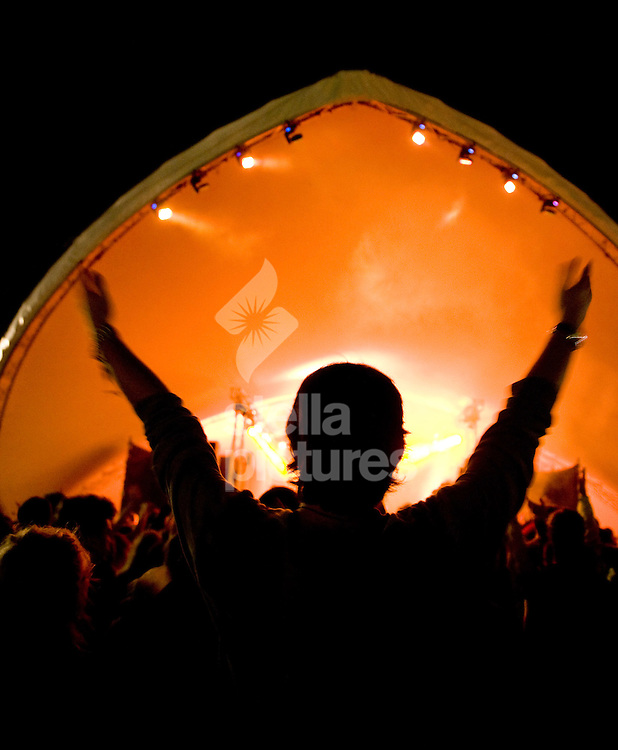 Picture by Daniel Hambury/Stella Pictures. .14/07/12.A man dances at Latitude, a music and arts festival in Suffolk..