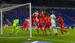 CARDIFF, WALES - Sunday, November 15, 2020: Wales' Kieffer Moore heads the ball clear during the UEFA Nations League Group Stage League B Group 4 match between Wales and Republic of Ireland at the Cardiff City Stadium. Wales won 1-0. (Pic by David Rawcliffe/Propaganda)