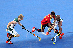 Marc Salles of Spain beats the defence of Julian Hykes of South Africa  during Pool MA Hockey  match between South Africa and Spain held at the Riverbank Arena in Olympic Park in London as part of the London 2012 Olympics on the 3rd August 2012..Photo by Ron Gaunt/SPORTZPICS