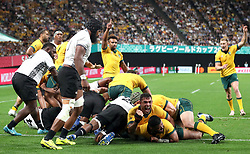 Australia's Silatolu Latu (bottom right) scores his second try during the 2019 Rugby World Cup Pool D match at Sapporo Dome.
