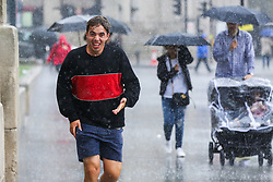 © Licensed to London News Pictures. 27/09/2019. London, UK. A man is seen running form cover during heavy downpour in London. According to the Met Office, this weekend is set to be washout with over 2o hours of rainfall in the capital. Photo credit: Dinendra Haria/LNP. Photo credit: Dinendra Haria/LNP