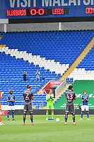 Football - 2019 / 2020 Sky Bet EFL Championship - Cardiff City vs. Leeds United<br /> <br /> players  in a minutes clapping in front of empty stands, at Cardiff City Stadium.<br /> <br /> COLORSPORT/WINSTON BYNORTH