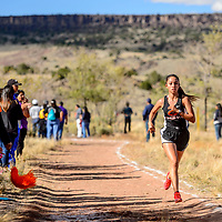 Gallup Bengal Jessica Ramirez runs the final meters of the  the girls varsity race in first place at the Grants High School Invitational cross country meet in Grants Friday.