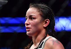"Nov 12, 2016 - New York, New York, U.S. - Miesha ""Cupcake"" Tate (red gloves) vs. Raquel ""Rocky"" Pennington (blue gloves) during UFC 205 at Madison Square Garden. (Credit Image: © Jason Silva via ZUMA Wire)"