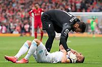 Football - 2021 / 2022 Premier League - Liverpool vs Burnley - Anfield - Saturday 21st August 2021<br /> <br /> Liverpool's Alisson Becker checks on Burnley's Johann Gudmundsson as he lays injured