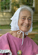 Old Bethpage, New York, USA. August 30, 2015. PATRICIA JOSEPH of College Point, wearing Civil War era style clothing, is a member of the Old Bethpage Village Dancers which danced throughout the Old Time Music Weekend at Old Bethpage Village Restoration, where popular music of the American Civil War period was performed, and visitors learned traditional 1800's contradances.