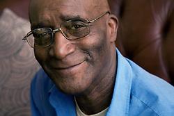 Portrait of older man smiling,