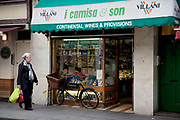 Camisa and Son Italian Deli on Old Compton Street, Soho, London. This small, family-run Italian delicatessen and grocers in Soho is a favourite with local workers and has a strong native following. In fact, you're bound to hear more Italian voices than English ones when you pop into the delicious smelling premises on Old Compton Street, whose walls are covered with popular Italian foods.