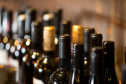 Bottles of wine line the wall at Pour Wine Bar and Bistro, in the Montclair district of Oakland, Calif., Wednesday, Dec. 23, 2015. (Photo by D. Ross Cameron)