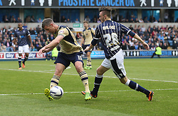 Leeds United's Michael Tonge clears under pressure from Millwall's Scott Malone - Photo mandatory by-line: Robin White/JMP - Tel: Mobile: 07966 386802 28/09/2013 - SPORT - FOOTBALL - The Den - Millwall - Millwall V Leeds United - Sky Bet Championship