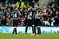 Jack Colback, Cheik Ismael Tiote, Fabricio Coloccini, Paul Dummett and Goalkeeper Jak Alnwick of Newcastle United, in his first Premier League appearance celebrate after Newcastle win 2-1 to inflict a first defeat in all competitions this season on Chelsea - Photo mandatory by-line: Rogan Thomson/JMP - 07966 386802 -06/12/2014 - SPORT - FOOTBALL - Newcastle, England - St James' Park - Newcastle United v Chelsea - Barclays Premier League.