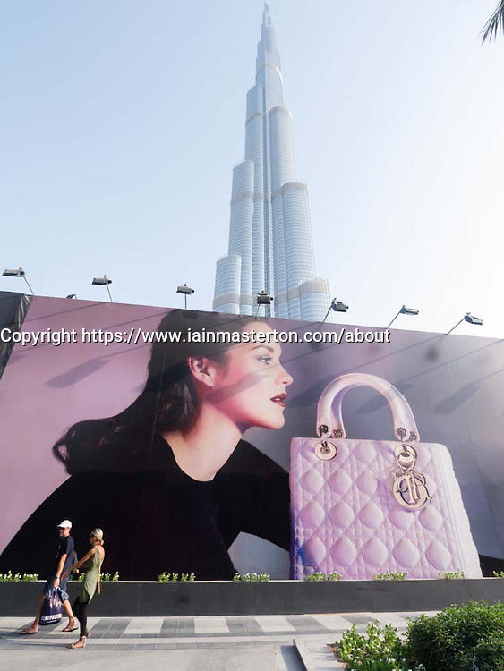 Large billboard advertising Dior fashion brand in front of construction work for Phase 2 expansion of  Dubai Mall In Dubai UAE